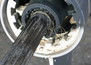 Image of fishing line around outboard motor gearbox prop shaft